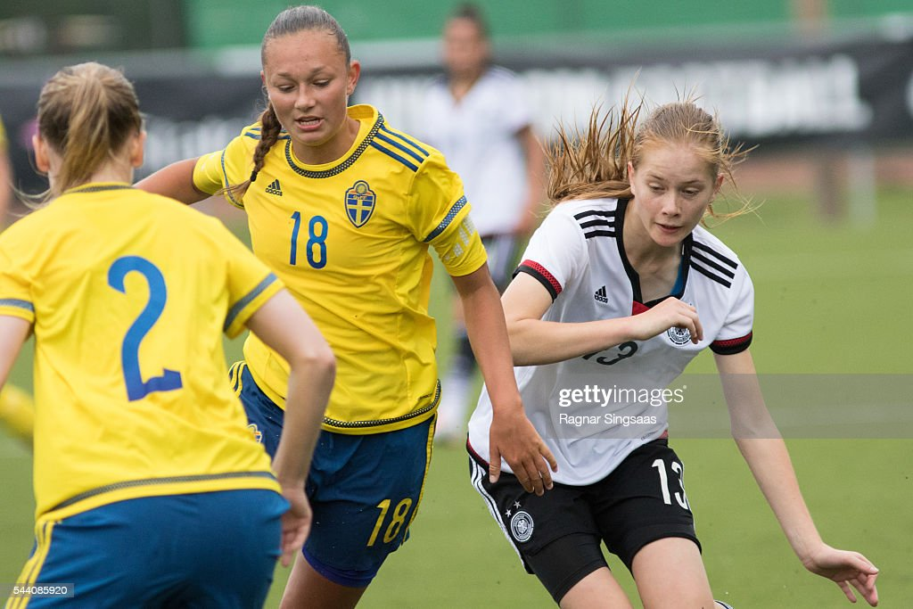 Julia Welin of Sweden and Sjoeke Nusken of Germany compete for the ball during the Nordic Cup game between U16 Girl's Germany v U16 Girl's Sweden on July 1, 2016 in Rade, Norway.