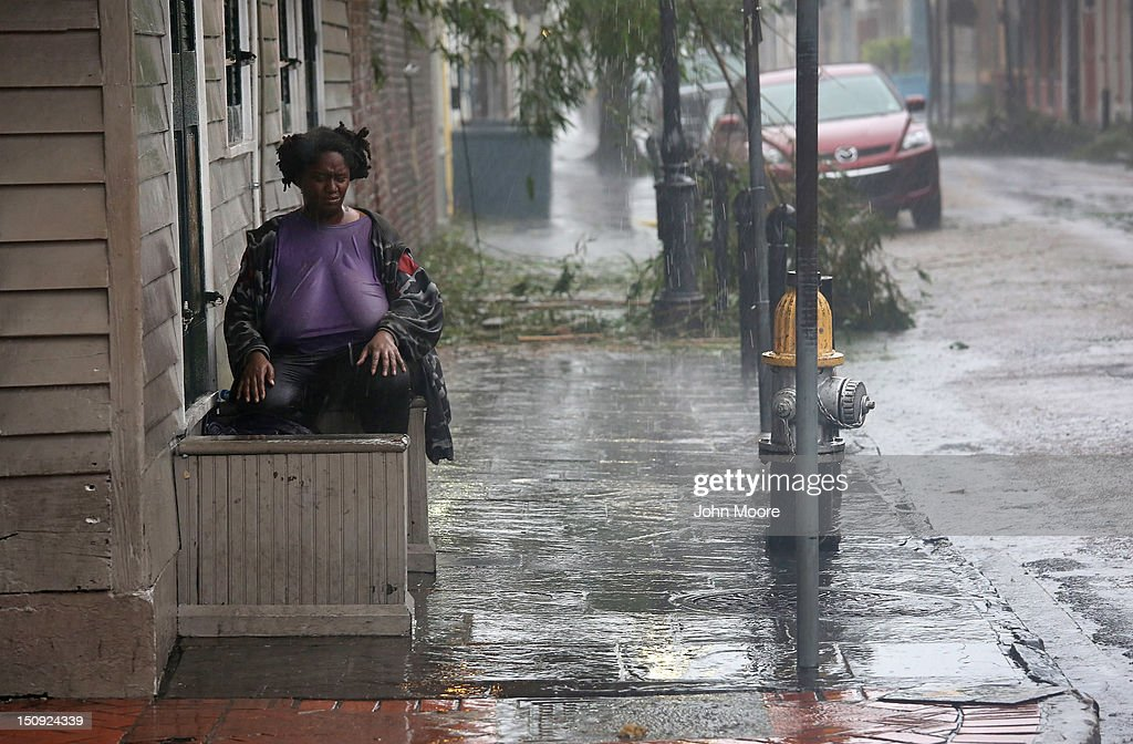 Julia Wilson sits and watches as rain from Hurricane Isaac falls over Bourbon Street on August 29 2012 in New Orleans Louisiana The Category 1...