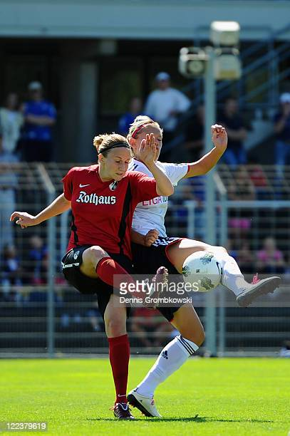 Julia Zirnstein of Freiburg and Julia Simic of Muenchen battle for the ball during the Women's Bundesliga match between SC Freiburg and Bayern...