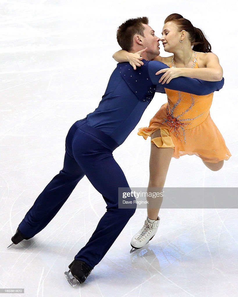 Julia Zlobina (R) and Alexei Sitnikov of Azerbaijan perform during the free dance of day two at Skate America at Joe Louis Arena on October 19, 2013 in Detroit, Michigan.