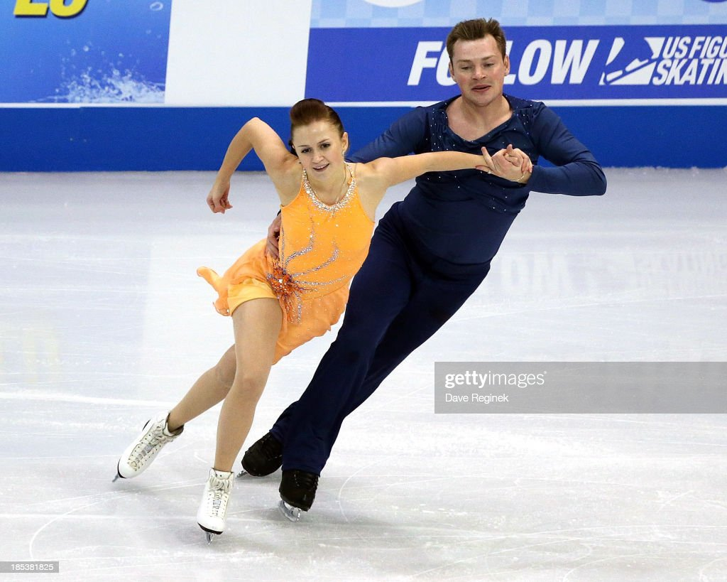 Julia Zlobina (L) and Alexei Sitnikov of Azerbaijan perform during the free dance of day two at Skate America at Joe Louis Arena on October 19, 2013 in Detroit, Michigan.