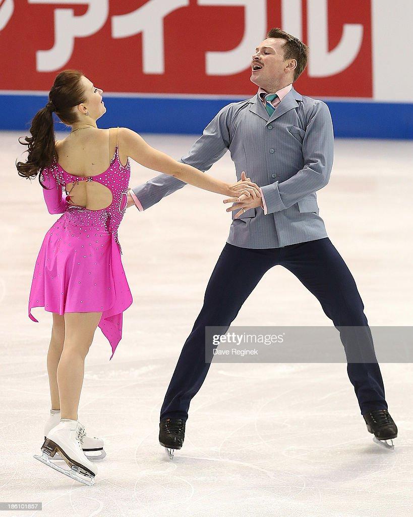 Julia Zlobnia and Alexei Sitnikov of Azerbaijan perform during the ice dance short program at Skate America at Joe Louis Arena on October 18, 2013 in Detroit, Michigan.