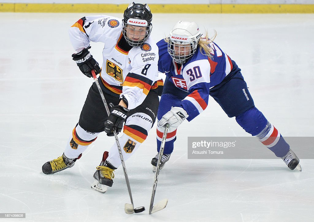 Julia Zorn of Germany and Lenka Srokova (R) of Slovakia compete for the puck in the match between Slovakia and Germany during day three of the Ice Hockey Women's 5 Nations Tournament at the Shin Yokohama Skate Center on November 9, 2013 in Yokohama, Japan.