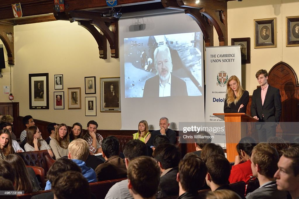 Julian Assange addresses the The Cambridge Union via videolink on November 11, 2015 in Cambridge, Cambridgeshire. During the address to Cambridge university students, Mr Assange reportedly played footage believed to have been taken from an Apache helicopter gunship showing the killing of Iraqi civilians.