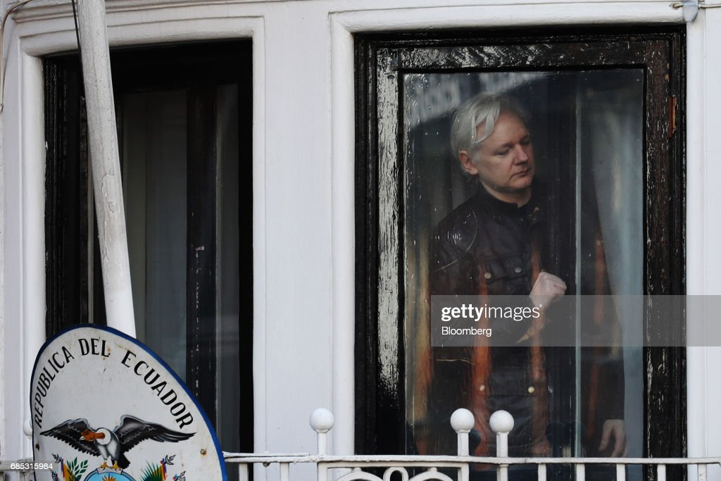 Julian Assange, founder of WikiLeaks, opens the door to a balcony to speak to media and supporters at the Ecuadorian embassy in London, U.K., on on Friday, May 19, 2017. Assange hailed a Swedish decision to drop a rape probe against him, but said he won't leave the Ecuadorian embassy in London where he has sought refuge for the past five years as long as he remains a target in the U.S. and U.K. Photographer: Luke MacGregor/Bloomberg via Getty Images
