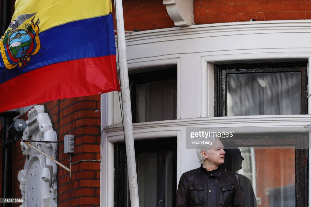 Julian Assange, founder of WikiLeaks, pauses while speaking to media and supporters from a balcony at the Ecuadorian embassy in London, U.K., on on Friday, May 19, 2017. Assange hailed a Swedish decision to drop a rape probe against him, but said he won't leave the Ecuadorian embassy in London where he has sought refuge for the past five years as long as he remains a target in the U.S. and U.K. Photographer: Luke MacGregor/Bloomberg via Getty Images