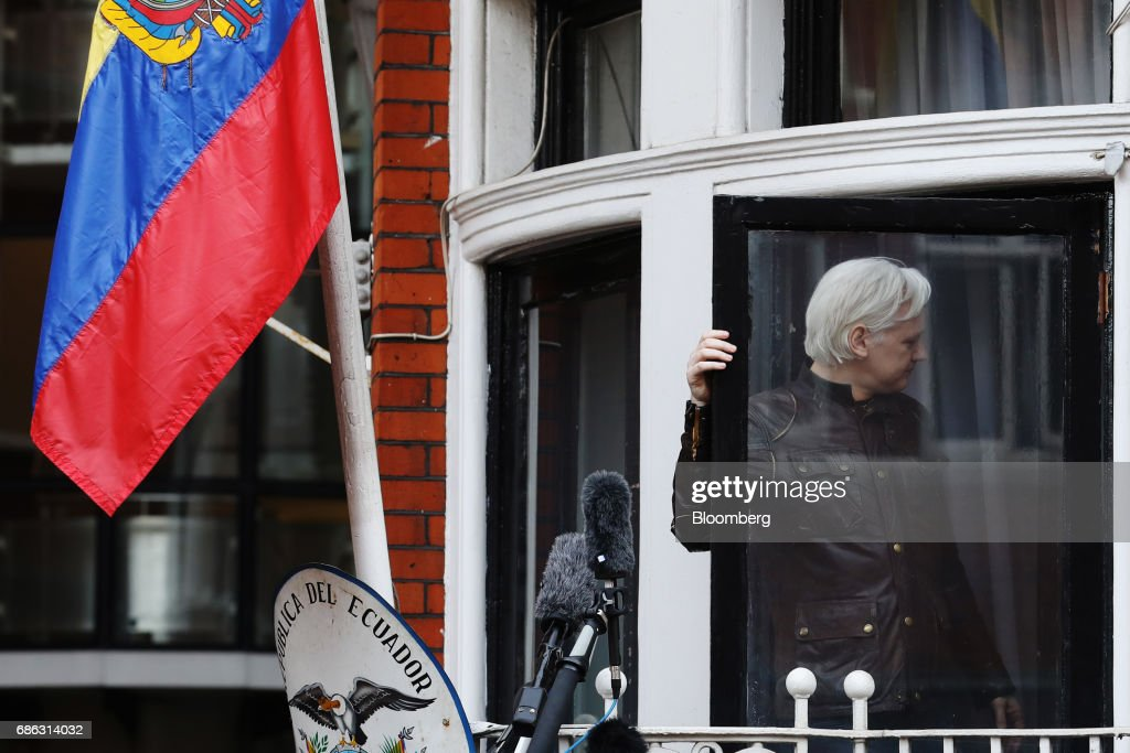 Julian Assange, founder of WikiLeaks, returns inside after speaking to media and supporters from a balcony at the Ecuadorian embassy in London, U.K., on on Friday, May 19, 2017. Assange hailed a Swedish decision to drop a rape probe against him, but said he won't leave the Ecuadorian embassy in London where he has sought refuge for the past five years as long as he remains a target in the U.S. and U.K. Photographer: Luke MacGregor/Bloomberg via Getty Images
