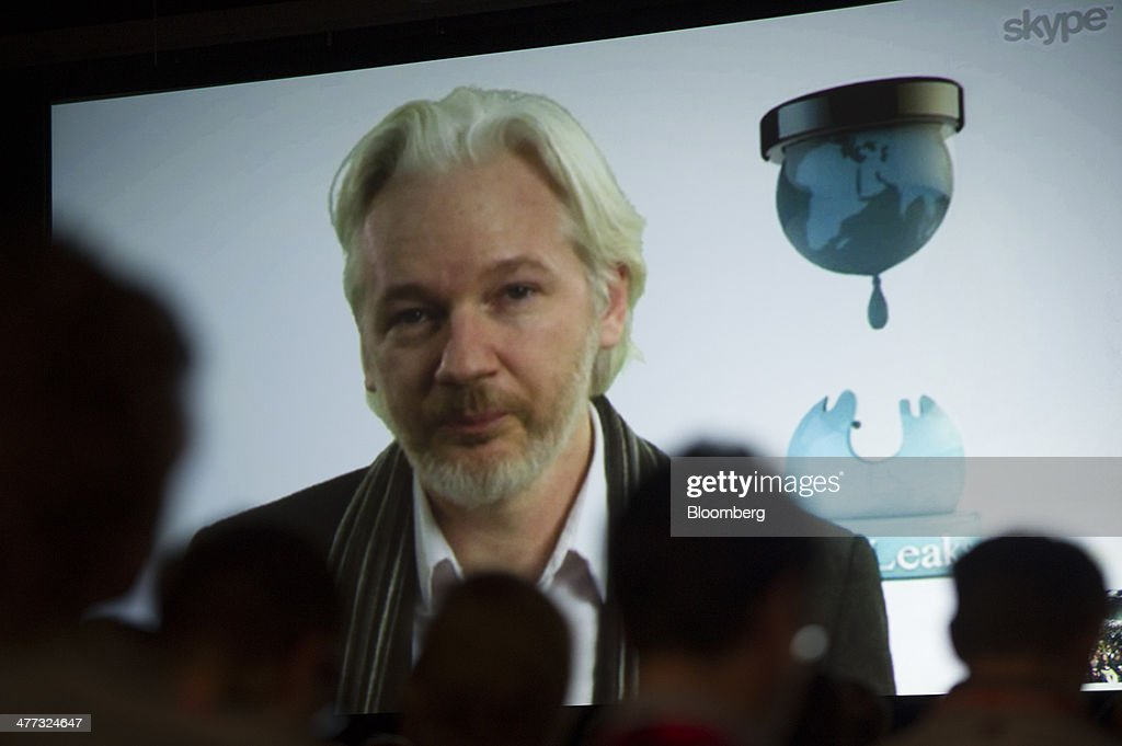 <a gi-track='captionPersonalityLinkClicked' href=/galleries/search?phrase=Julian+Assange&family=editorial&specificpeople=7117000 ng-click='$event.stopPropagation()'>Julian Assange</a>, founder of WikiLeaks, speaks on screen during a panel discussion at the South By Southwest (SXSW) Interactive Festival in Austin, Texas, U.S., on Saturday, March 8, 2014. The SXSW conferences and festivals converge original music, independent films, and emerging technologies while fostering creative and professional growth. Photographer: David Paul Morris/Bloomberg via Getty Images