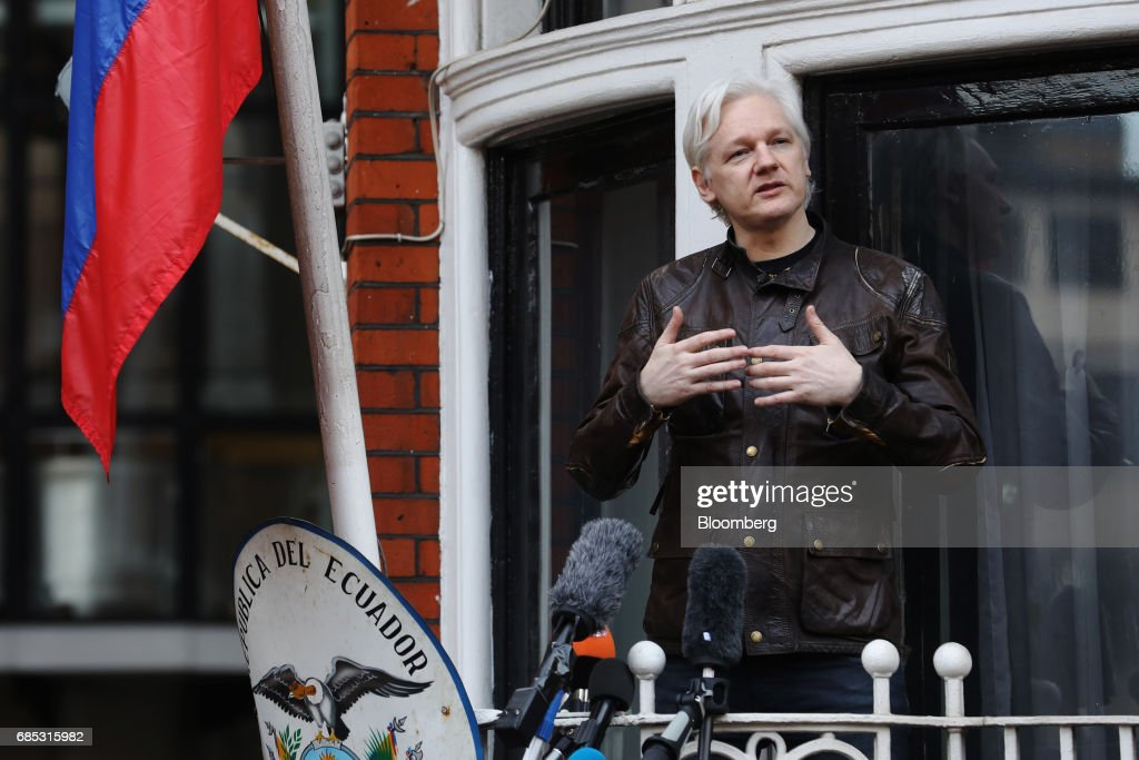 Julian Assange, founder of WikiLeaks, speaks to media and supporters from a balcony at the Ecuadorian embassy in London, U.K., on on Friday, May 19, 2017. Assange hailed a Swedish decision to drop a rape probe against him, but said he won't leave the Ecuadorian embassy in London where he has sought refuge for the past five years as long as he remains a target in the U.S. and U.K. Photographer: Luke MacGregor/Bloomberg via Getty Images