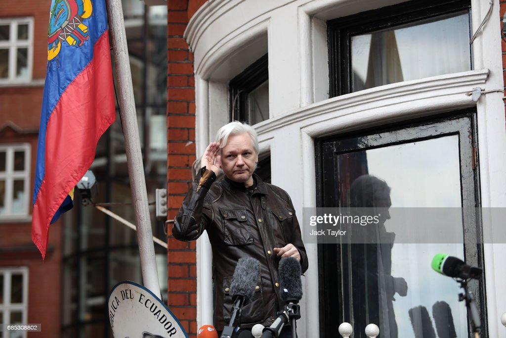 Julian Assange gestures as he speaks to the media from the balcony of the Embassy Of Ecuador on May 19, 2017 in London, England. Julian Assange, founder of the Wikileaks website that published US Government secrets, has been wanted in Sweden on charges of rape since 2012. He sought asylum in the Ecuadorian Embassy in London and today police have said he will still face arrest if he leaves.