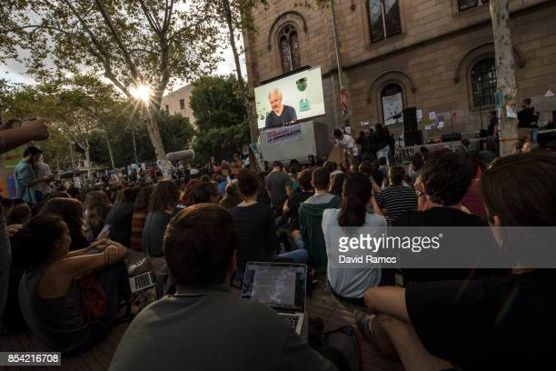 Julian Assange holds a video conference with Catalan students outside the University of Barcelona on September 26 2017 in Barcelona Spain Catalan...