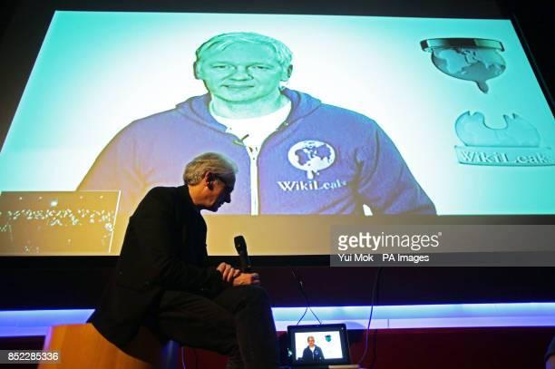 Julian Assange who is a member of the Raindance Film Festival jury appears on screen via Skype at a Raindance Film Festival screening at Vue...