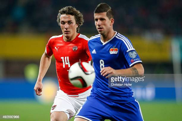 Julian Baumgartlinger of Austria competes for the ball with Sandro Wieser of Liechtenstein during the UEFA EURO 2016 Qualifier between Austria and...