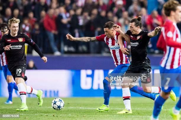 Julian Baumgartlinger of Bayer 04 Leverkusen battles for the ball with Lucas Hernandez of Atletico de Madrid during their 201617 UEFA Champions...