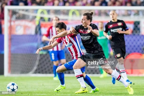 Julian Baumgartlinger of Bayer 04 Leverkusen fights for the ball with Yannick Ferreira Carrasco of Atletico de Madrid during their 201617 UEFA...