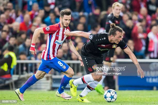 Julian Baumgartlinger of Bayer 04 Leverkusen fights for the ball with Saul Niguez Esclapez of Atletico de Madrid during their 201617 UEFA Champions...