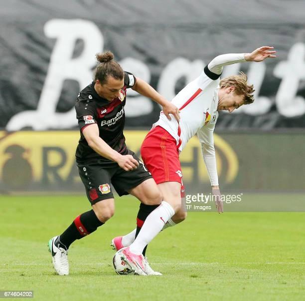 Julian Baumgartlinger of Bayer Leverkusen and Emil Forsberg of Leipzig during the Bundesliga match between RB Leipzig and Bayer 04 Leverkusen at Red...