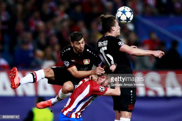 Julian Baumgartlinger of Bayer Leverkusen and his temmate Aleksandar Dragovic blocks Saul Niguez of Atletico de Madrid during the UEFA Champions...