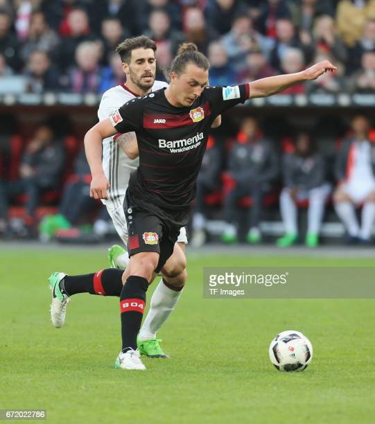 Julian Baumgartlinger of Leverkusen and Javier Martinez of Munich controls the ball during the Bundesliga match between Bayer 04 Leverkusen and...