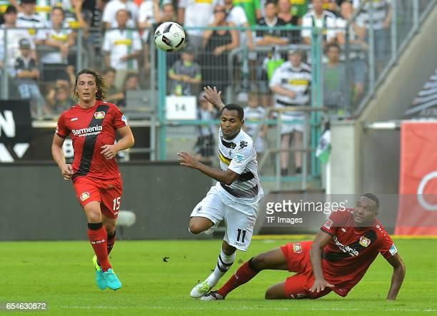 Julian Baumgartlinger of Leverkusen and Jonathan Tah of Leverkusen and Raffael of Moenchengladbach battle for the ball during the Bundesliga match...