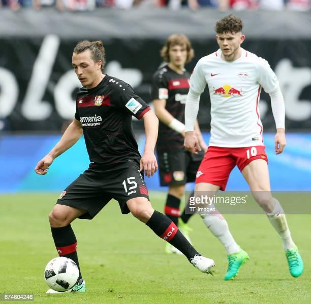 Julian Baumgartlinger of Leverkusen and Oliver Burke of Leipzig battle for the ball during the Bundesliga match between RB Leipzig and Bayer 04...