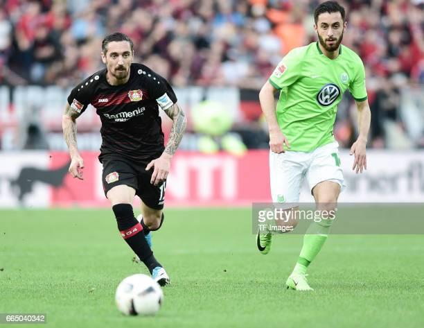 Julian Baumgartlinger of Leverkusen and Yunus Mali of Wolfsburg battle for the ball during the Bundesliga match between Bayer 04 Leverkusen and VfL...