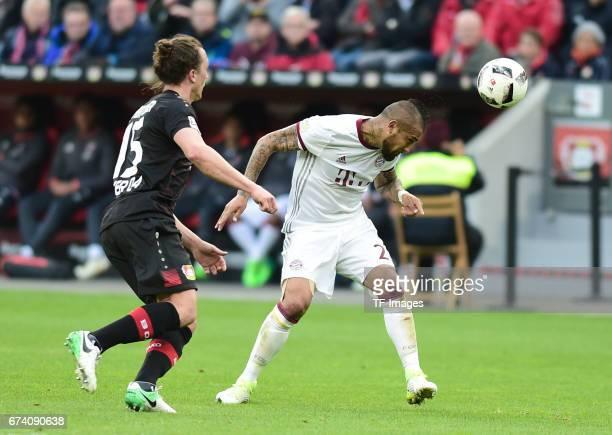 Julian Baumgartlinger of Leverkusen Arturo Vidal of Munich battle for the ball during the Bundesliga match between Bayer 04 Leverkusen and Bayern...