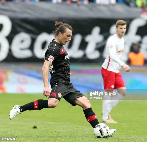 Julian Baumgartlinger of Leverkusen battle for the ball during the Bundesliga match between RB Leipzig and Bayer 04 Leverkusen at Red Bull Arena on...