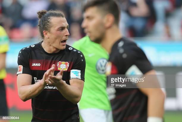 Julian Baumgartlinger of Leverkusen gestures during the Bundesliga match between Bayer 04 Leverkusen and VfL Wolfsburg at BayArena on April 2 2017 in...