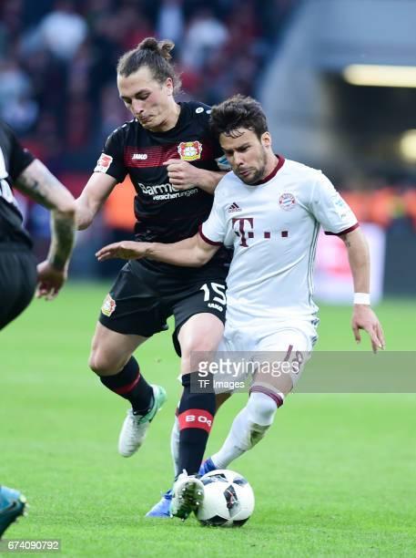 Julian Baumgartlinger of Leverkusen Juan Bernat of Munich battle for the ball during the Bundesliga match between Bayer 04 Leverkusen and Bayern...