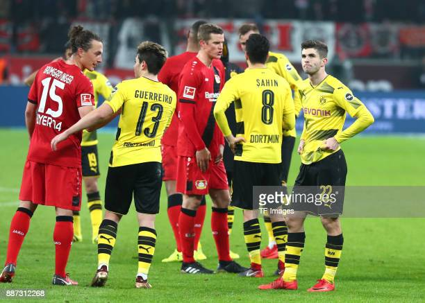 Julian Baumgartlinger of Leverkusen Raphael Guerreiro of Dortmund Sven Bender Nuri Sahin of Dortmund and Christian Pulisic of Dortmund look dejected...