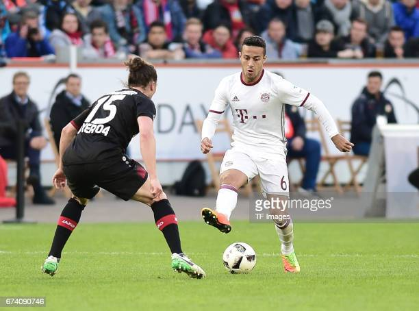 Julian Baumgartlinger of Leverkusen Thiago of Munich battle for the ball during the Bundesliga match between Bayer 04 Leverkusen and Bayern Muenchen...