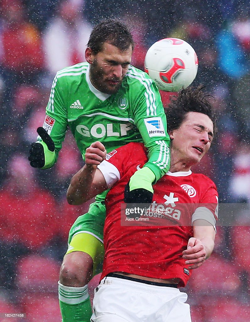 Julian Baumgartlinger (front) of Mainz is challenged by <a gi-track='captionPersonalityLinkClicked' href=/galleries/search?phrase=Bas+Dost&family=editorial&specificpeople=7467816 ng-click='$event.stopPropagation()'>Bas Dost</a> of Wolfsburg during the Bundesliga match between 1. FSV Mainz 05 and VfL Wolfsburg at Coface Arena on February 23, 2013 in Mainz, Germany.