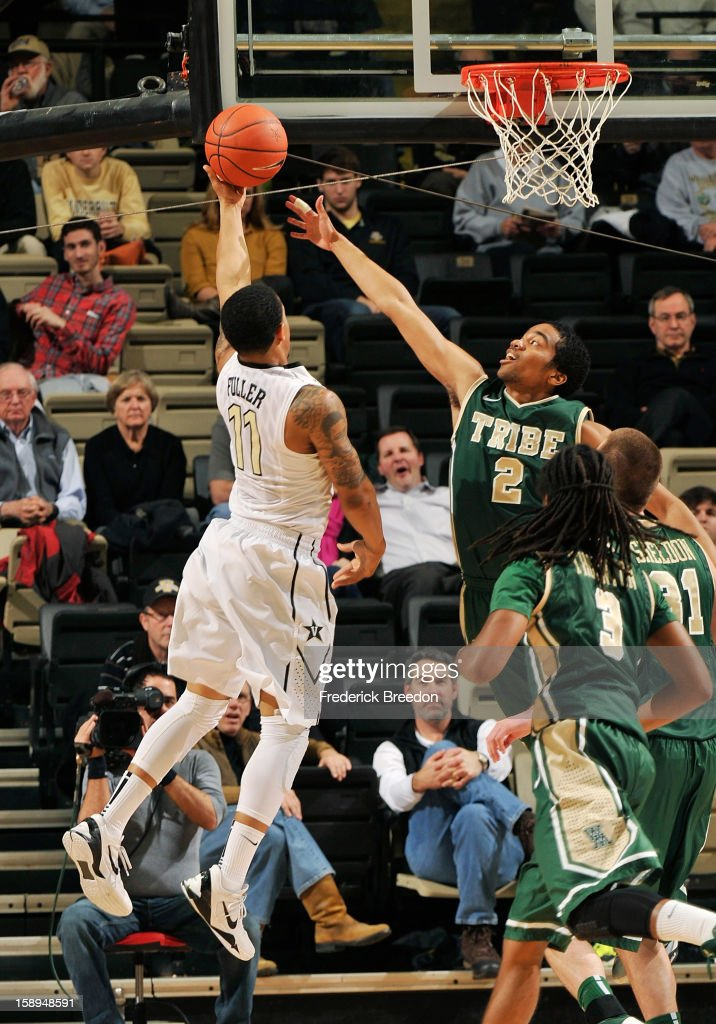 Julian Boatner #2 of William and Mary tries to block a shot against Kyle Fuller #11of the Vanderbilt Commodores at Memorial Gym on January 2, 2013 in Nashville, Tennessee.