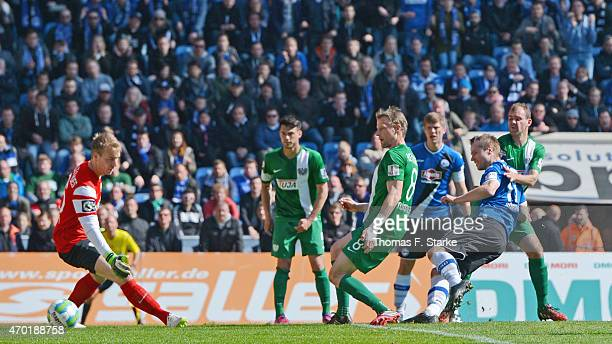 Julian Boerner of Bielefeld scores his teams second goal against goalkeeper Maximilian Schulze Niehues of Muenster during the Third League match...