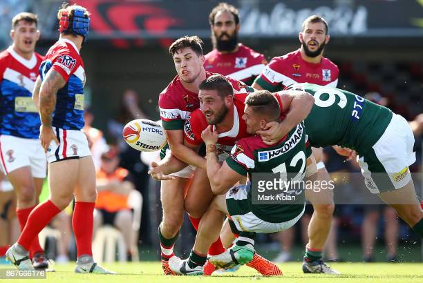 Julian Bousquet of France offloads during the 2017 Rugby League World Cup match between France and Lebanon at Canberra Stadium on October 29 2017 in...