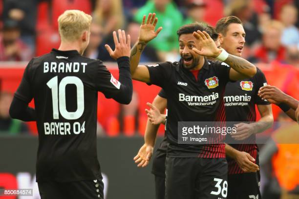 Julian Brandt and Karim Bellarabi celebrate a goal during the Bundesliga match between Bayer 04 Leverkusen and SC Freiburg at BayArena on September...