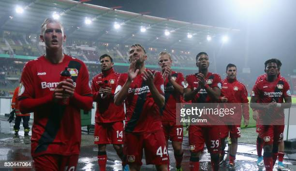Julian Brandt and team mates of Leverkusen celebrate after the DFB Cup first round match between Karlsruher SC and Bayer Leverkusen at...