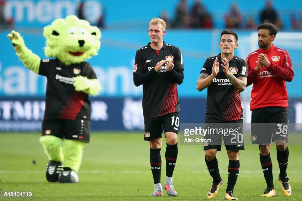 Julian Brandt Charles Aranguiz and Karim Bellarabi of Leverkusen celebrate after the Bundesliga match between Bayer 04 Leverkusen and SC Freiburg at...