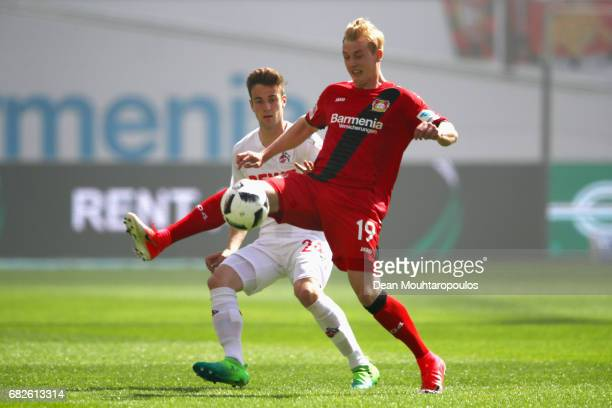 Julian Brandt of Bayer 04 Leverkusen battles for the ball with Lukas Klunter of Koeln during the Bundesliga match between Bayer 04 Leverkusen and 1...