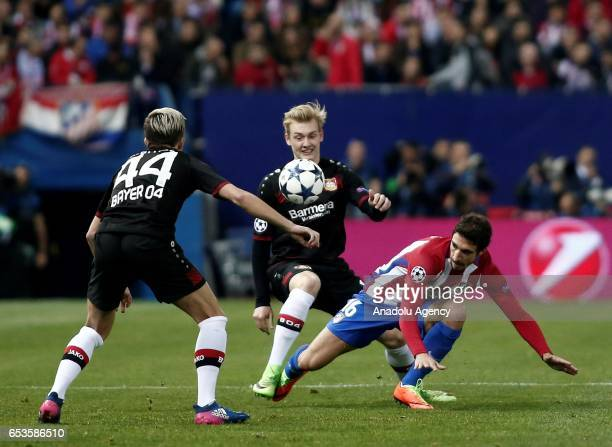 Julian Brandt of Bayer 04 Leverkusen in action against Sime Vrsaljko of Atletico Madrid during the UEFA Champions League Round of 16 football match...