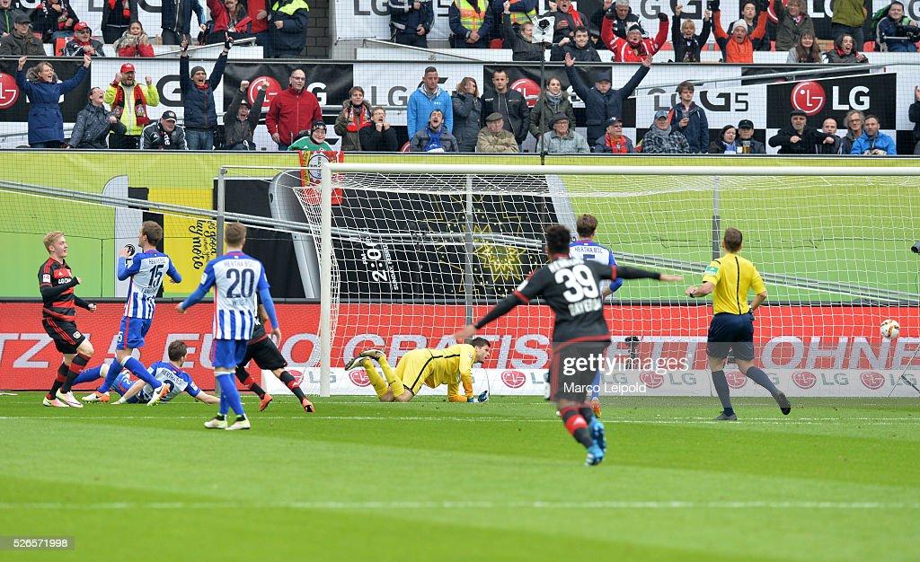 Julian Brandt of Bayer 04 Leverkusen scores the 1:0 against Rune Almenning Jarstein of Hertha BSC during the game between Bayer 04 Leverkusen and Hertha BSC on april 30, 2016 in Leverkusen, Germany.