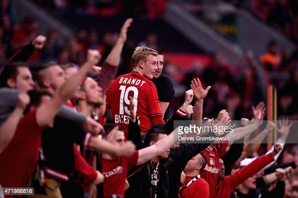 Julian Brandt of Bayer Levekusen celebrates with fans after the Bundesliga match between Bayer 04 Leverkusen and FC Bayern Muenchen at BayArena on...