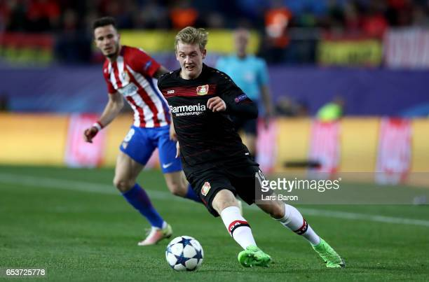 Julian Brandt of Bayer Leverkusen runs with the ball during the UEFA Champions League Round of 16 second leg match between Club Atletico de Madrid...