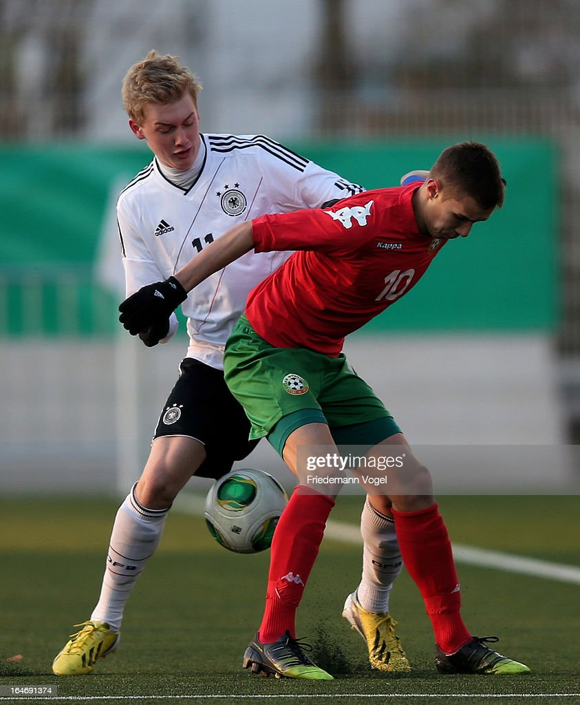 Julian Brandt of Germany and Antonio Vutov of Bulgaria battle for the ball during the UEFA Under17 Elite Round match between Germany and Bulgaria at Toennies-Arena on March 26, 2013 in Rheda-Wiedenbruck, Germany.