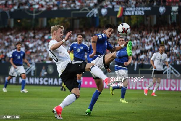 Julian Brandt of Germany and Davide Cesarini of San Marino battle for the ball during the FIFA 2018 World Cup Qualifier between Germany and San...