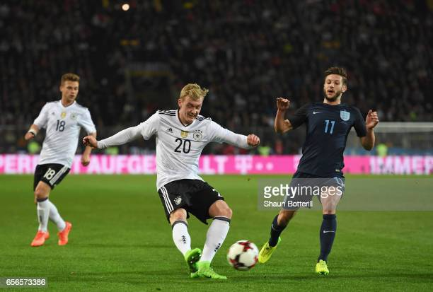 Julian Brandt of Germany attempts a cross while Adam Lallana of England attempts to block during the international friendly match between Germany and...