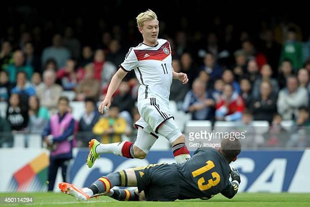 Julian Brandt of Germany attempts to score past goalkeeper Ruben Blanco of Spain during the UEFA Under 19 Elite Round match between U19 Spain and U19...