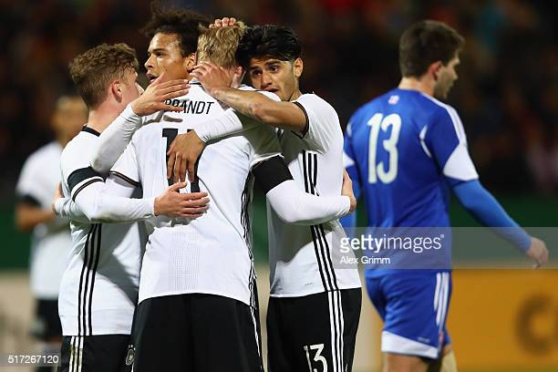 Julian Brandt of Germany celebrates his team's fourth goal with team mates Mahmoud Dahoud and Leroy Sane during the 2017 UEFA European U21...