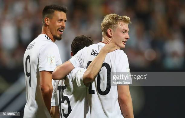 Julian Brandt of Germany celebrates scoring his sides sixith goal with Sandro Wagner of Germany and Amin Younes of Germany during the FIFA 2018 World...